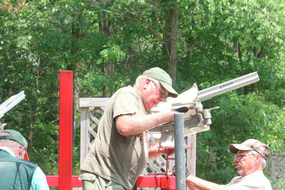 Mecosta County Rod & Gun Club members set equipment up for last week's sporting clays shoot. (Pioneer photo/John Raffel)