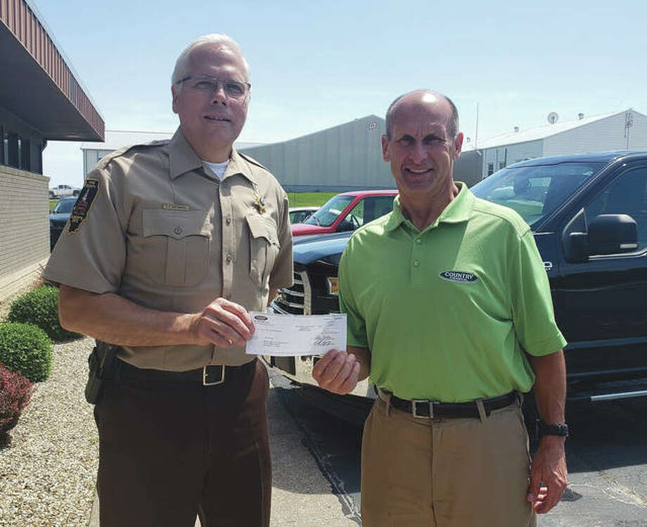 Pike County Sheriff David Greenwood receives a $2,500 check from Mike Spann of Country Financial. Photo: Photo Provided