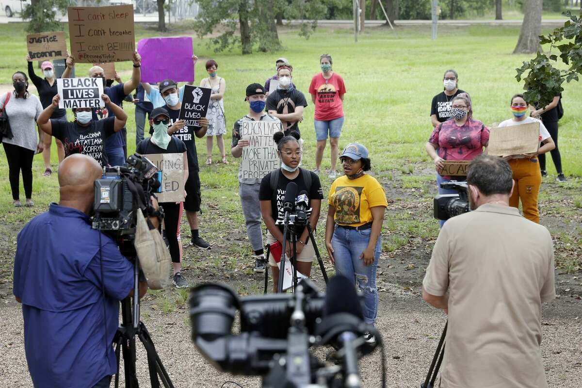 Protest organizers, from left, Avery Collins and Alise Maxie, speak to the media with other demonstrators behind them during a rally and march demanding justice for Breonna Taylor held at Hermann Park at the Bayou Parkland Pavillion Friday, Jun. 26, 2020 in Houston, TX. Taylor was killed in Kentucky by police at her home as they were executing a no-knock warrant.