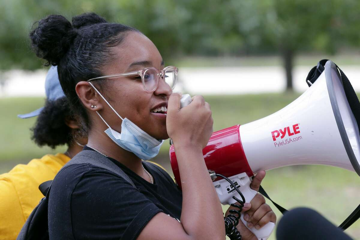 Avery Collins, one of the protest organizers, uses a bull horn to announce the start of a rally and march demanding justice for Breonna Taylor held at Hermann Park at the Bayou Parkland Pavillion Friday, Jun. 26, 2020 in Houston, TX. Taylor was killed in Kentucky by police at her home as they were executing a no-knock warrant.