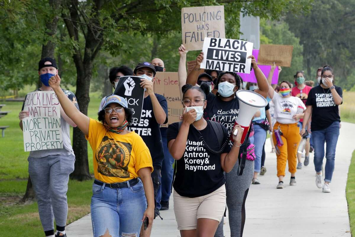 Alise Maxie, in yellow, and Avery Collins, in black, lead protestors out of the park in a march demanding justice for Breonna Taylor at Hermann Park Friday, Jun. 26, 2020 in Houston, TX.