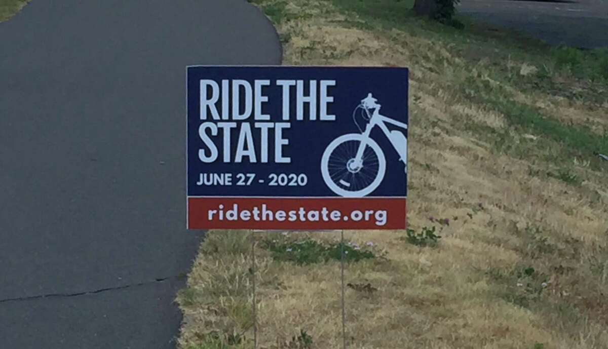 Signs promoting the 57-mile Ride the State along the East Coast Greenway