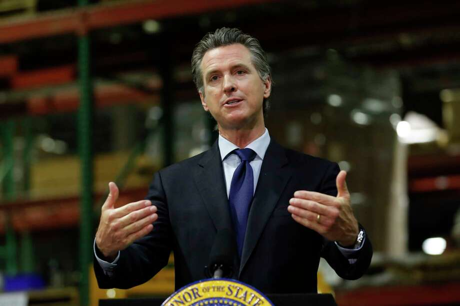 In this photo taken Friday, June 26, 2020, Gov. Gavin Newsom speaks about the coronavirus pandemic as he gives an update on the state's response to it at a news conference in Rancho Cordova, Calif. Newsom issued his sharpest warning yet about the rising coronavirus threat and announced for the first time that the state had asked a county to shut back down, pleaded with Californians to wear masks and reminded them that dozens of people are dying each day. Photo: Rich Pedroncelli, AP / Copyright 2020 The Associated Press. All rights reserved