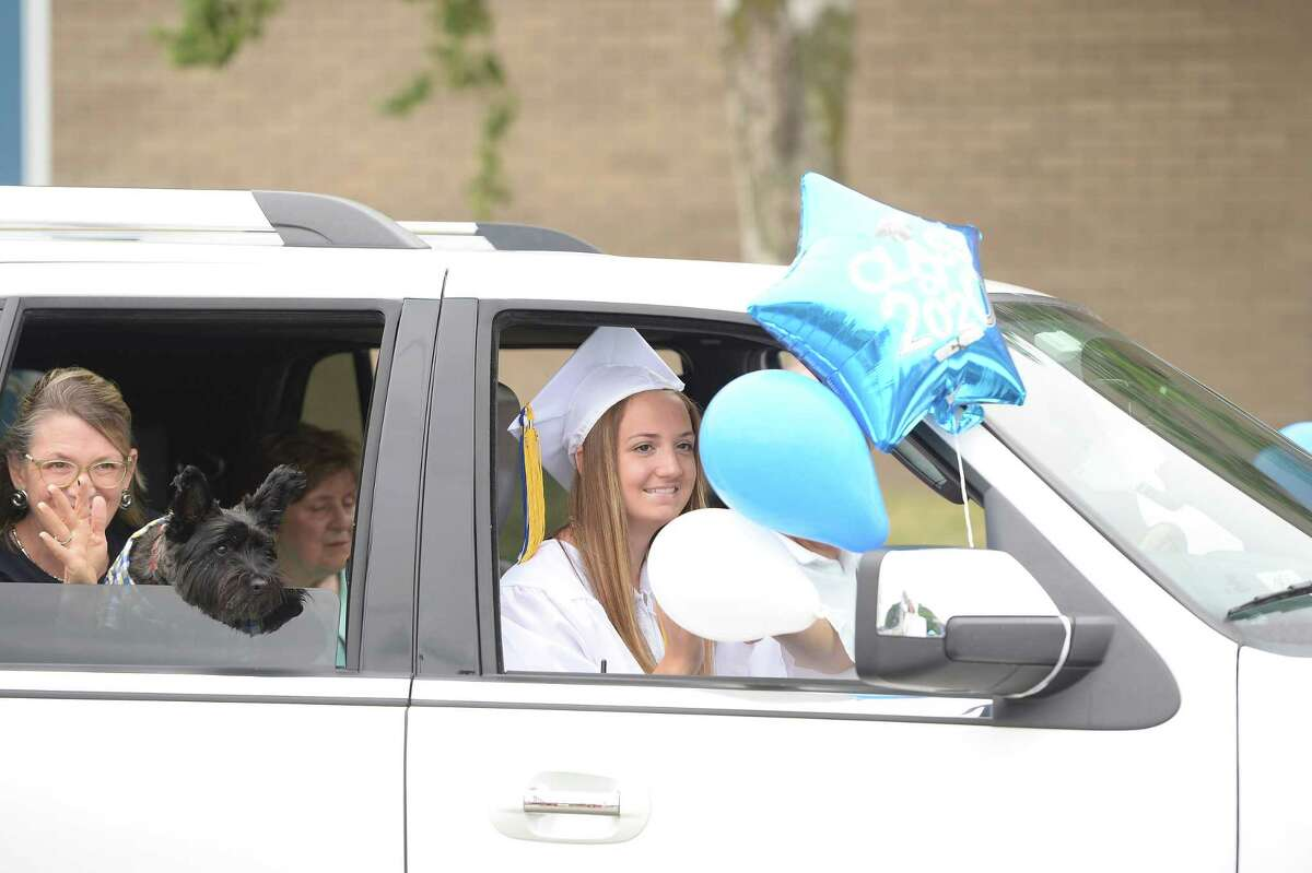 Shaker High School senior Olivia Rowley waves to supporters at the school's drive-thru graduation on Saturday, Jun. 27, 2020 in Colonie, N.Y. (Jenn March, Special to the Times Union )