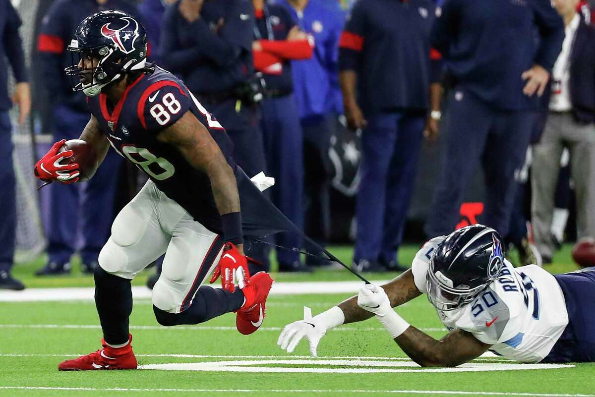 Tight end Jordan Akins, breaking a tackle against the Titans last season, could be in line for a breakout year in 2020.