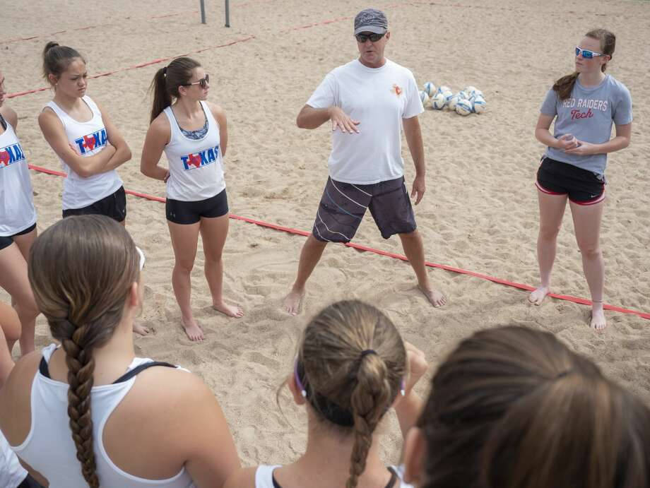 Professional sand volleyball player Adam Johnson works with youth player 06/27/2020 at the sand volleyball courts at Stonegate Fellowship Church. Tim Fischer/Reporter-Telegram Photo: Tim Fischer/Midland Reporter-Telegram