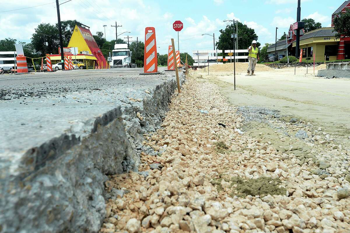 Road crews continue work on the Washington Boulevard road project Tuesday. The project is one of many that city budgets cover. Beaumont City Council received its proposed 2017 fiscal year budget Tuesday, upon which it will set future public hearings. Photo taken Tuesday, August 9, 2016 Kim Brent/The Enterprise