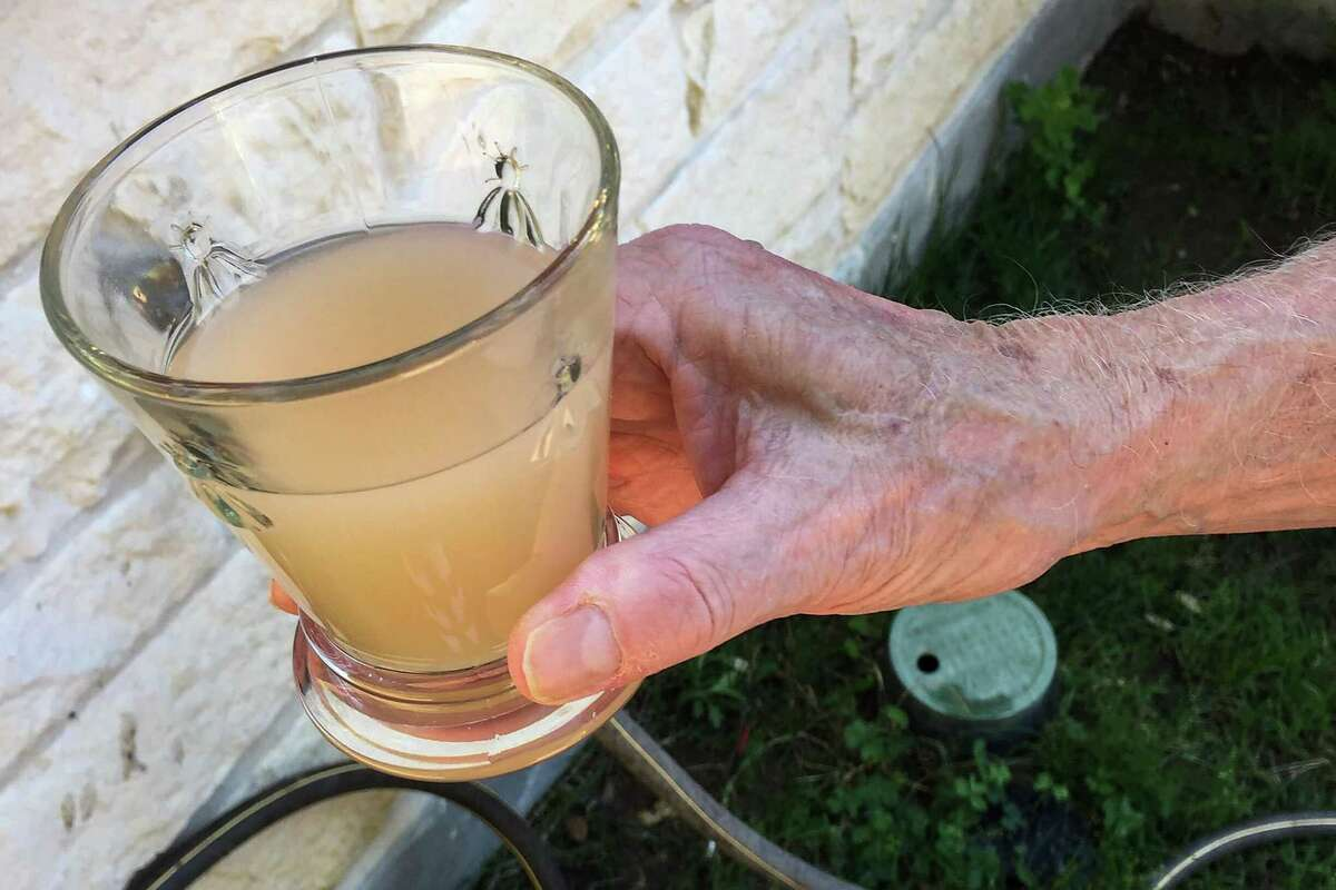 A glass of water from Max and Paula Fowler's water well is shown in this May 6, 2020, family photo, in Blanco, Texas. After crews working for pipeline giant Kinder Morgan spilled drilling fluid during a boring operation near the Blanco River in late March, several homeowners say their wells were contaminated.