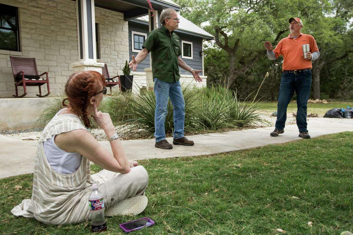 Rep. Chip Roy, R-Texas, far right, talks to Max and Paula Fowler about their water problems outside their home on Monday, May 11, 2020 in Blanco, Texas. After crews working for pipeline giant Kinder Morgan spilled drilling fluid during a boring operation near the Blanco River in late March, several homeowners say their wells were contaminated. The Fowler's water has been contaminated.