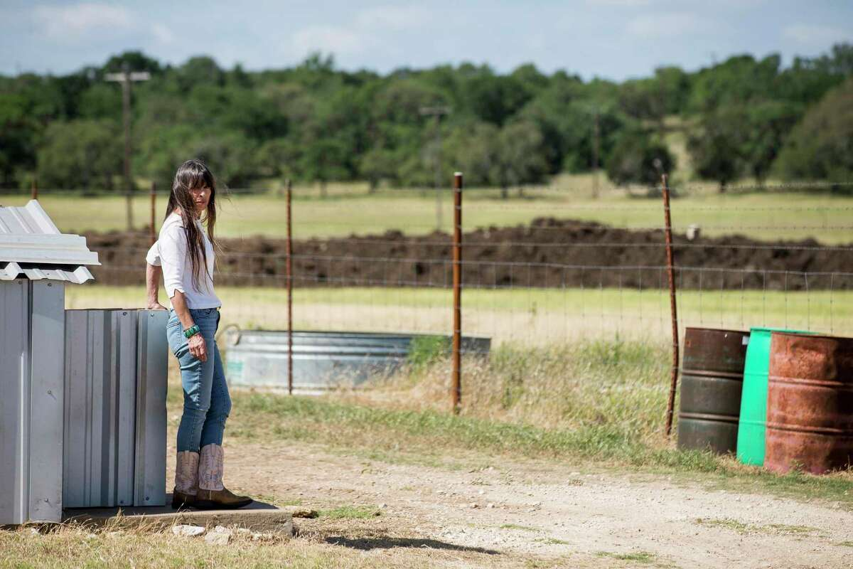 Katherine McClure stands by her water well, within sight of where a natural gas pipeline boring operation is underway on Monday, May 11, 2020 in Blanco, Texas. After crews working for pipeline giant Kinder Morgan spilled drilling fluid during a boring operation near the Blanco River in late March, several homeowners say their wells were contaminated.