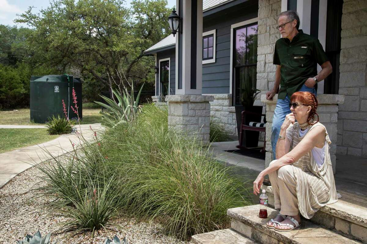 Max and Paula Fowler are out on their front porch near their now required new water tank on Monday, May 11, 2020 in Blanco, Texas. After crews working for pipeline giant Kinder Morgan spilled drilling fluid during a boring operation near the Blanco River in late March, several homeowners say their wells were contaminated. The Fowler's water is contaminated, forcing them to install the water tank.