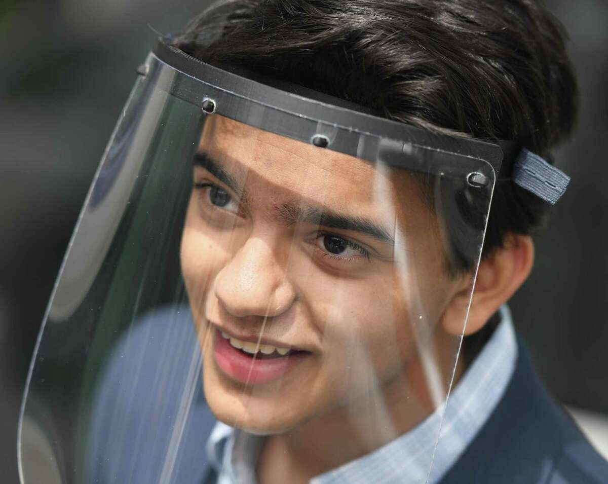 Greenwich's Arjun Dayal, 17, presents a donation of 3D-printed face shields to medical workers at White Plains Hospital in White Plains, N.Y. Monday, April 20, 2020.