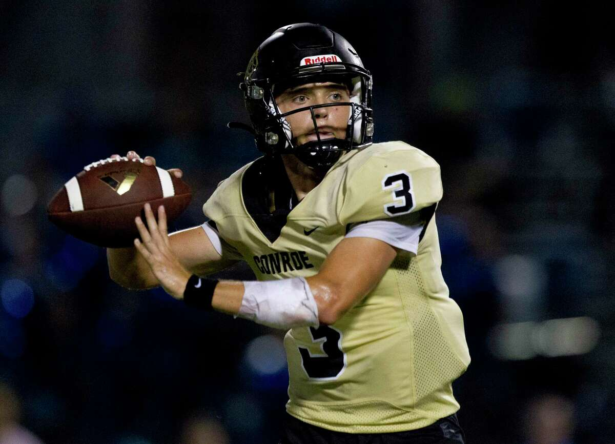 Conroe quarterback Christian Pack (3) drops back to pass during the fourth quarter of a District 15-6A high school football game at Buddy Moorhead Stadium, Friday, Oct. 4, 2019, in Conroe.