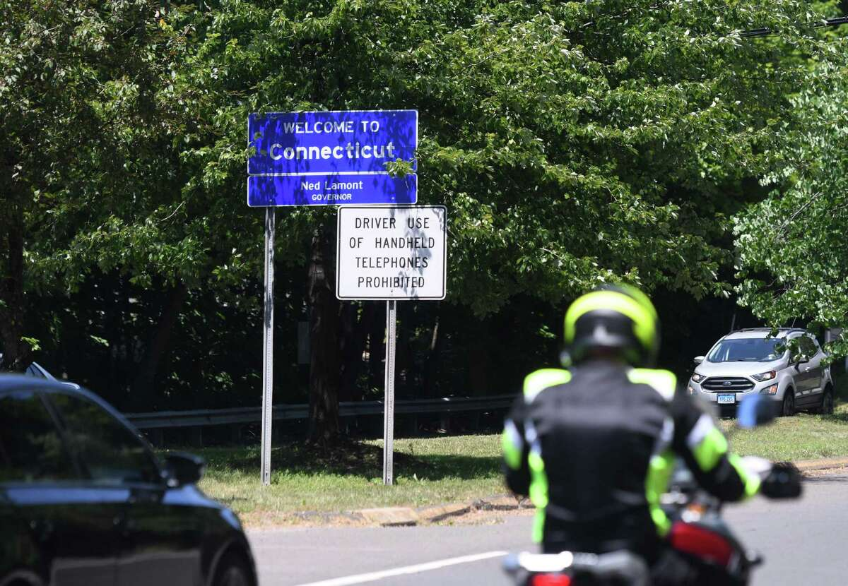 A sign welcomes drivers to Greenwich, Conn. along Route 1 at its border with Port Chester, N.Y. on Wednesday, June 24, 2020. Ever since the coronavirus pandemic hit the northeast, Greenwich has seen an increase in people coming from New York to buy and rent homes and condos.