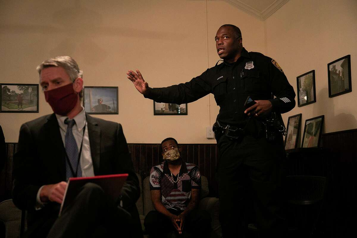 """SAPD Officer Richard Odoms, right, talks about traffic stop procedures during a town hall meeting on """"Criminal Justice Reform"""" and """"Policing in our communities moving forward"""" in San Antonio on Wednesday, June 24, 2020. The town hall was the third meeting on the topic. At left is Christian Henricksen, Chief of Litigation at the Bexar County District Attorney's Office, and center is SAPD Officer Levon Harrison."""
