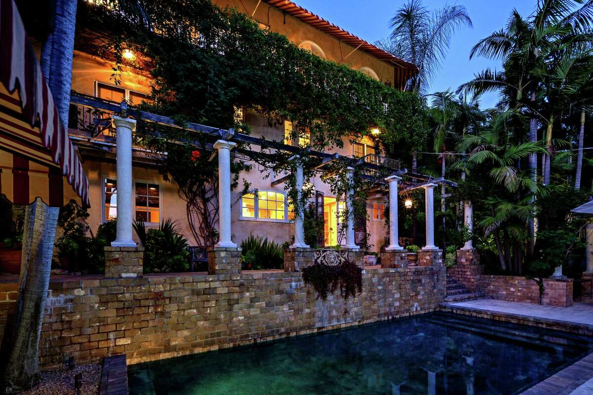 Comic actor Michael McDonald is asking about $3 million for his Hollywood Hills home of nearly two decades. The three-story Tuscan residence features arched French doors that open to a series of patios and Juliet balconies. Striped awnings lend a Parisian vibe to the 2,756-square-foot house, which is accompanied by ivy-covered patio space, a dining patio and a pool. (Marco Carocari Photography/TNS)