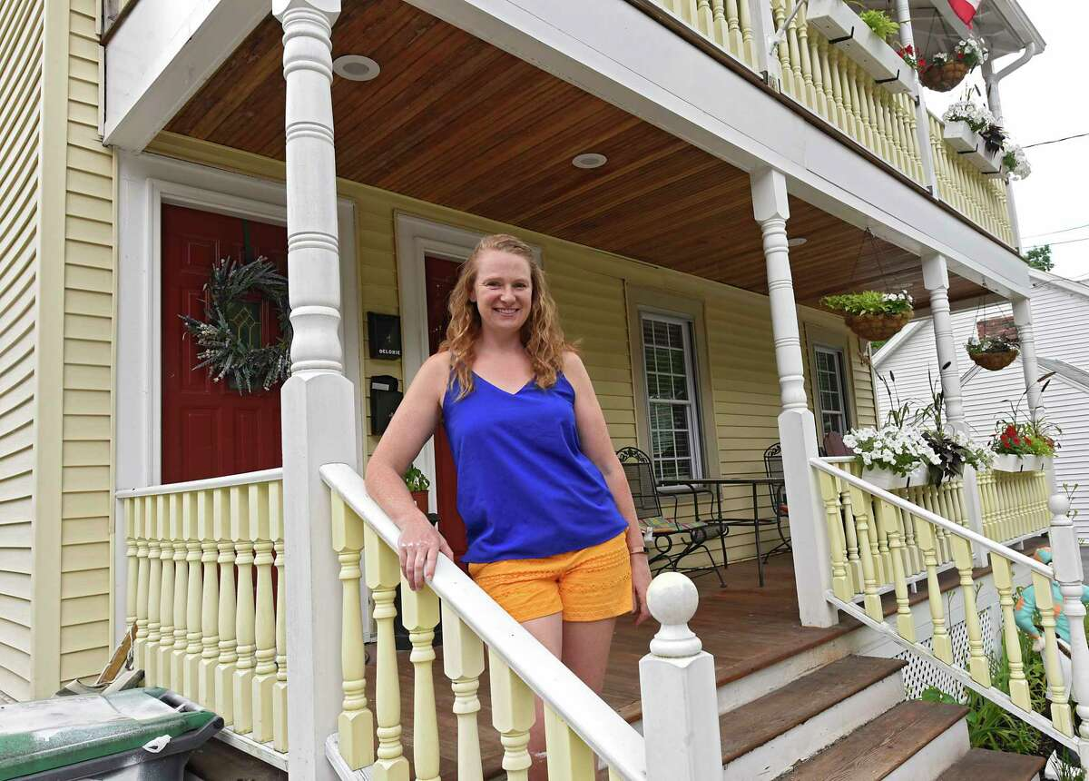 Alexis Davenport stands on the porch of her home which is also an Airbnb on Tuesday, June 23, 2020 in Saratoga Springs, N.Y. Alexis owns the home with her husband Josh. (Lori Van Buren/Times Union)