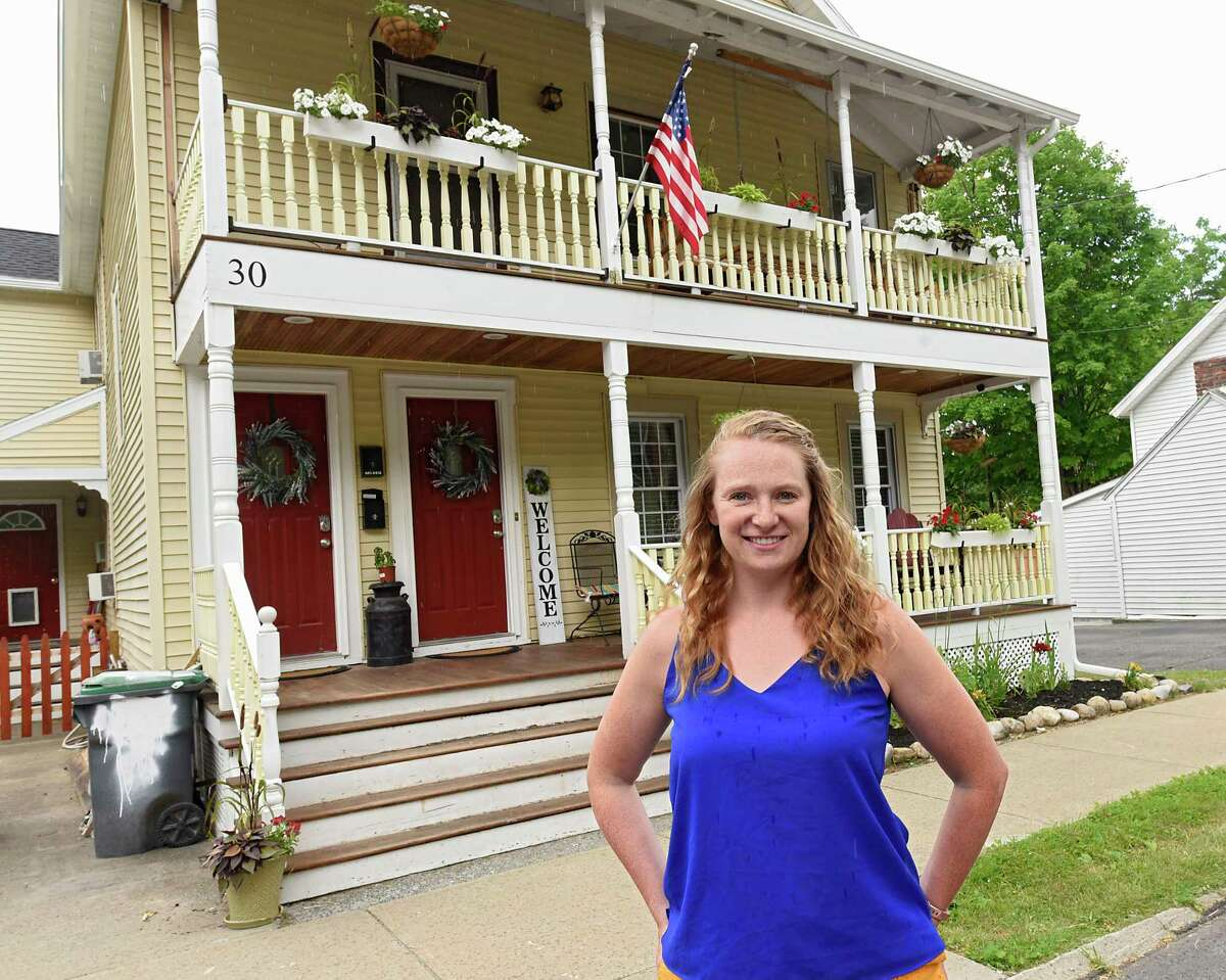Alexis Davenport stands in front of her home which is also an Airbnb on Tuesday, June 23, 2020 in Saratoga Springs, N.Y. Alexis owns the home with her husband Josh. (Lori Van Buren/Times Union)