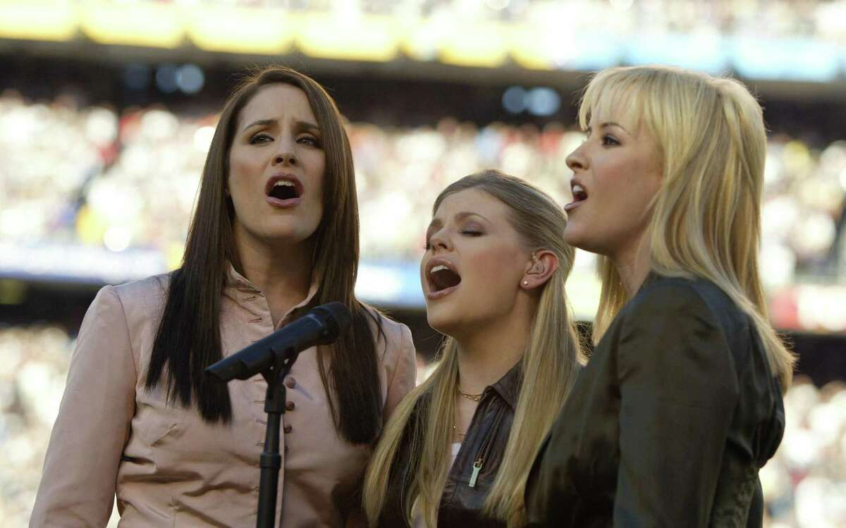 The Dixie Chicks perform the national anthem at Super Bowl XXXVII in 2003. The trio is now simply known as The Chicks.