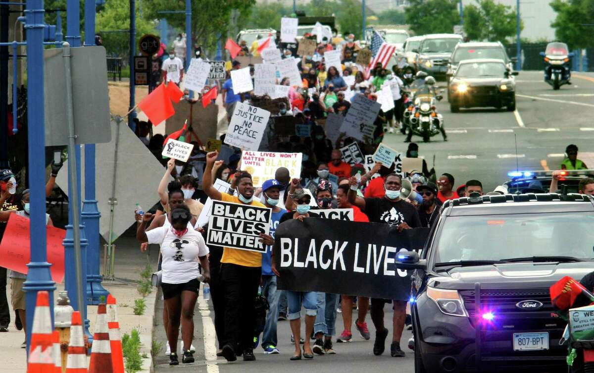 Several hundred Black Lives Matter protesters hold a Unity in the Community march along Stratford Ave over to the Margaret Morton Government Center on Broad Street in downtown Bridgeport, Conn., on Saturday, June 27, 2020. Hundreds gathered at Baker-Isaac Funeral home on Stratford Ave on the East Side to stage before marching to downtown. At the center Mayor Joe Ganim, Councilman Mary McBride-Lee, Rev. Herron Gaston and others spoke, including Rev. Dr. W. Franklyn Richardson from the National Action Network. Rev. Richardson spoke in place of Rev. Al Sharpton who was unable to attend.