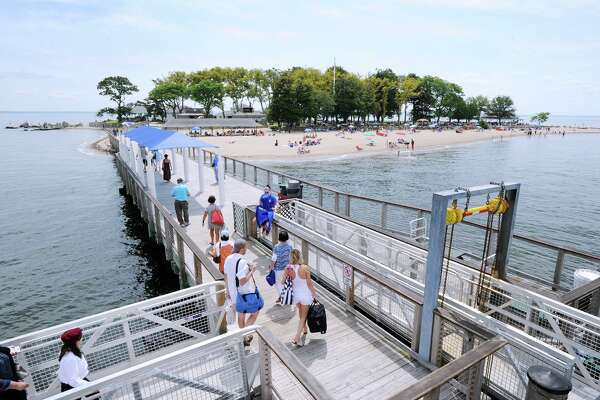 Passengers disembark the Island Beach ferry onto Island Beach off the coast of Greenwich, Conn., Saturday, August 25, 2018.