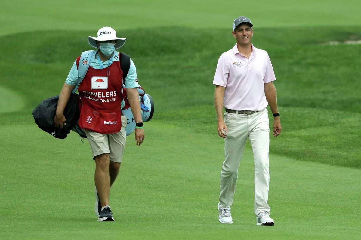 Brendon Todd, right, walks with his caddie Nick Jones as they approach the 15th green during the third round of the Travelers Championship golf tournament at TPC River Highlands, Saturday, June 27, 2020, in Cromwell, Conn. (AP Photo/Frank Franklin II)