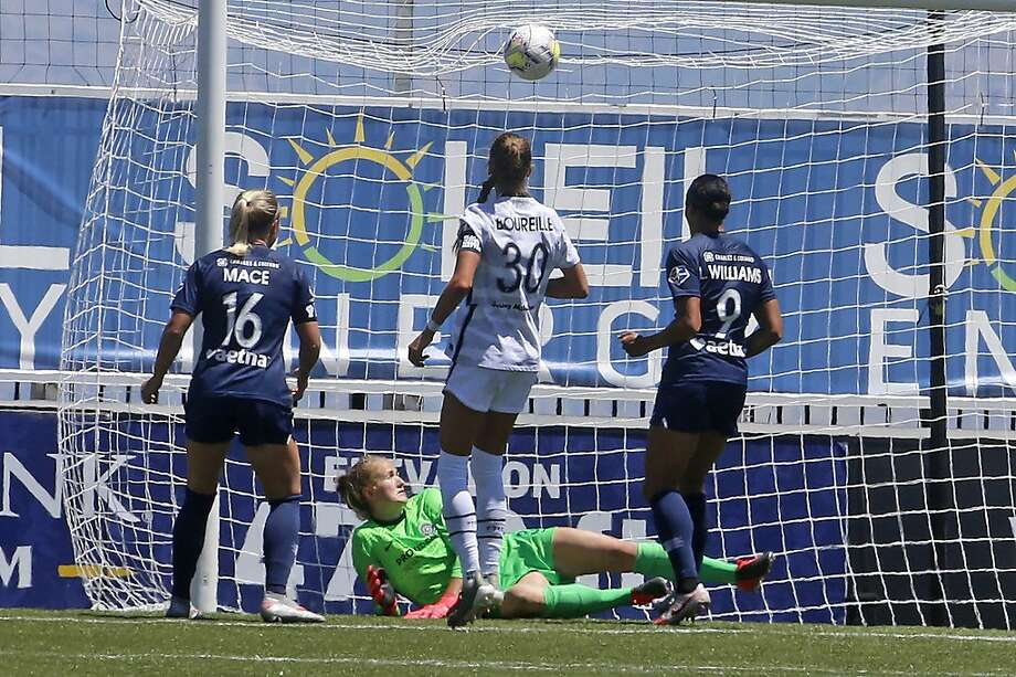 North Carolina forward Lynn Williams (right) scores the winning goal past Portland goalkeeper Bella Bixby. Photo: Rick Bowmer / Associated Press