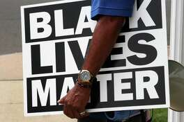 Several hundred Black Lives Matter protesters hold a unity march along Stratford Ave over to the Margaret Morton Government Center on Broad Street in downtown Bridgeport, Conn., on Saturday, June 27, 2020. Hundreds gathered at Baker-Isaac Funeral home on Stratford Ave on the East Side to stage before marching to downtown. Once at the center Mayor Joe Ganim, Councilman Mary McBride-Lee, march organizer Rev. Herron Gaston, activist Xavier Longwa and others spoke, including Rev. Dr. W. Franklyn Richardson from the National Action Network. Rev. Richardson spoke in place of Rev. Al Sharpton who was unable to attend.