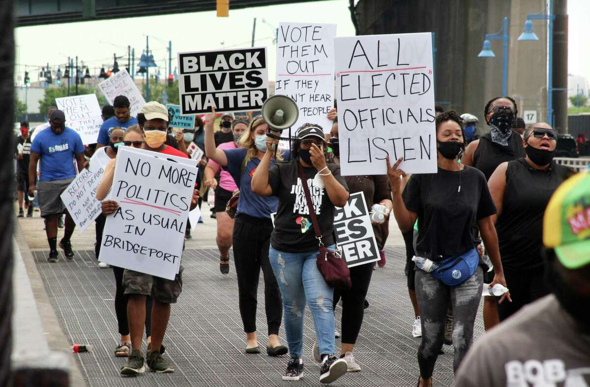 Several hundred Black Lives Matter protesters hold a Unity in the Community march along Stratford Ave over to the Margaret Morton Government Center on Broad Street in downtown Bridgeport, Conn., on Saturday, June 27, 2020. Hundreds gathered at Baker-Isaac Funeral home on Stratford Ave on the East Side to stage before marching to downtown. Once at the center Mayor Joe Ganim, Councilman Mary McBride-Lee, march organizer Rev. Herron Gaston, activist Xavier Longwa and others spoke, including Rev. Dr. W. Franklyn Richardson from the National Action Network. Rev. Richardson spoke in place of Rev. Al Sharpton who was unable to attend.