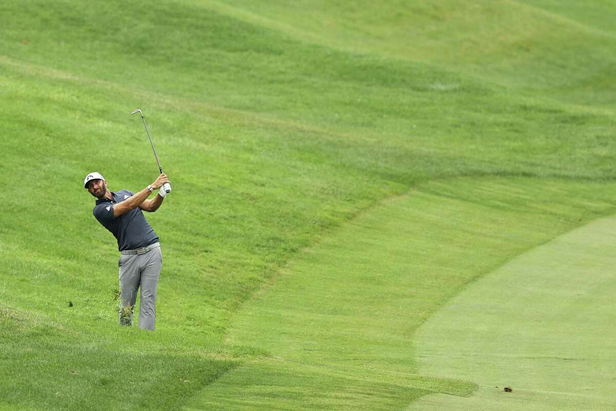 CROMWELL, CONNECTICUT - JUNE 27: Dustin Johnson of the United States plays a shot on the 18th hole during the third round of the Travelers Championship at TPC River Highlands on June 27, 2020 in Cromwell, Connecticut. (Photo by Elsa/Getty Images)