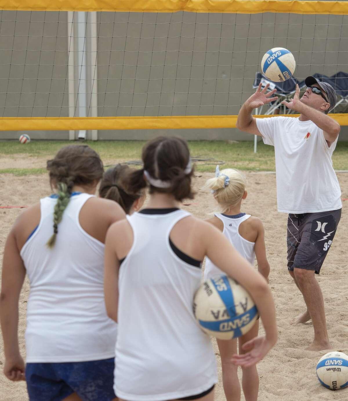 Professional sand volleyball player Adam Johnson works with youth player 06/27/2020 at the sand volleyball courts at Stonegate Fellowship Church. Tim Fischer/Reporter-Telegram