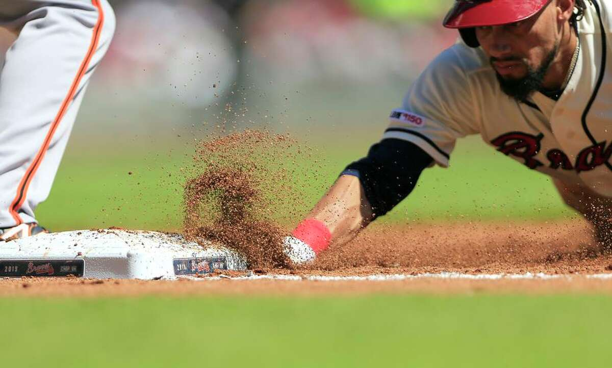 Speedy Billy Hamilton, seen with the Braves, could be useful as a pinch-runner with baseball's new rule for extra innings.