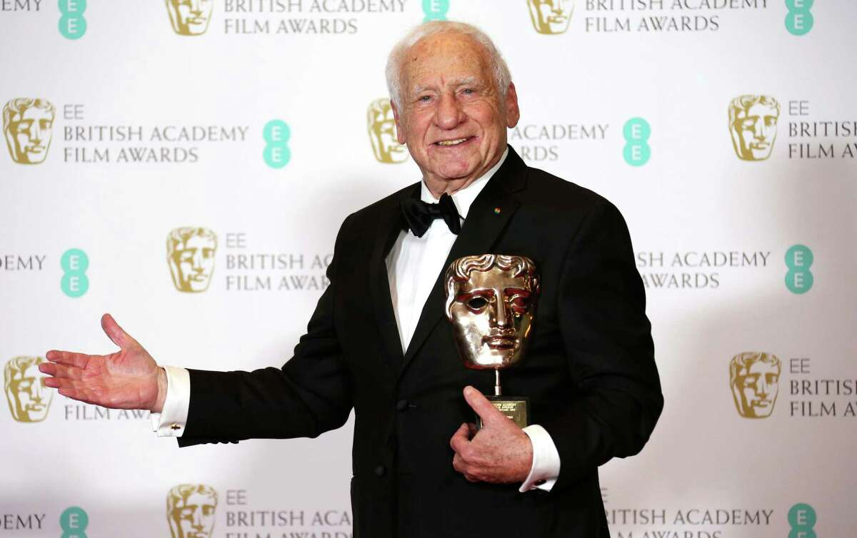FILE - In this Feb. 12, 2017 file photo, Mel Brooks poses for photographers with his BAFTA Fellowship award backstage at the British Academy Film Awards in London. Brooks turns 94 on June 28. (Photo by Joel Ryan/Invision/AP, File)