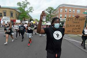 Fitzgerald Francois of Greenwich marches with protesters Saturday.