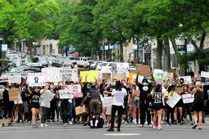 A couple hundred protesters join with organizers of Justice for Brunch on Saturday, June 27, 2020 as they march from Greenwich Town Hall down Greenwich Avenue to a rally at the Island Beach Lot where speakers called for change and reform, highlighting recent national events and localizing racism they say is present in Greenwich, Connecticut.