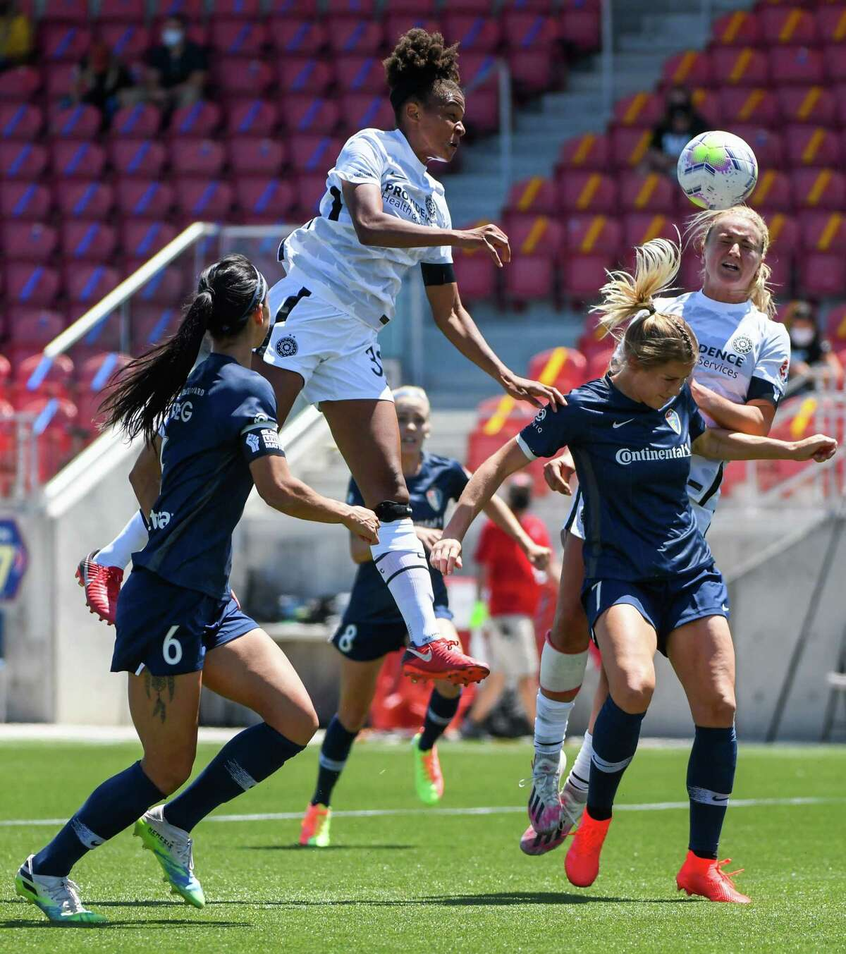 HERRIMAN, UT - JUNE 27: Simone Charley #38 and Lindsey Horan #10 of Portland Thorns FC jump over McCall Zerboni #7 of North Carolina Courage for a header during the first round of the NWSL Challenge Cup at Zions Bank Stadium on June 27, 2020 in Herriman, Utah. (Photo by Alex Goodlett/Getty Images)