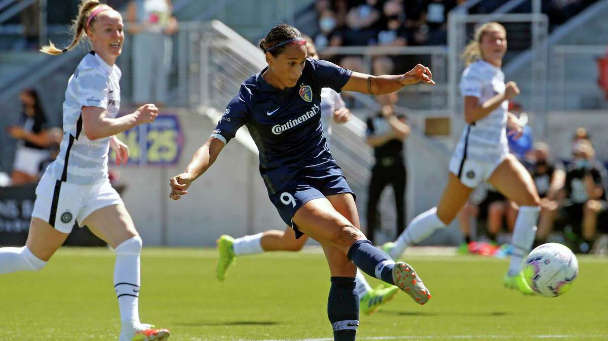 North Carolina Courage forward Lynn Williams (9) takes a shot during the first half of an NWSL Challenge Cup soccer match against Portland Thorns FC at Zions Bank Stadium Saturday, June 27, 2020, in Herriman, Utah. (AP Photo/Rick Bowmer)