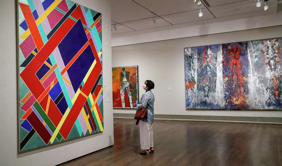 Sumathi Annalyapa looks at a painting as the exhibition Soul of a Nation opened up at the MFAH, Saturday, June 27, 2020, in Houston .