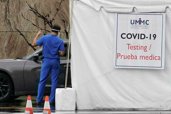 Testing is shown in the drive through line at the COVID-19 testing site at United Memorial Medical Center, 510 W Tidwell Rd., amid the COVID-19 pandemic Thursday, June 25, 2020, in Houston.