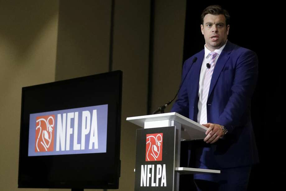 FILE - In a Thursday, Jan. 30, 2020 file photo, Eric Winston, president of the NFL Players Association, speaks at the annual state of the NFLPA press conference, in Miami Beach, Fla. NFL players have approved a new labor agreement with the league that features a 17-game regular season, higher salaries, increased roster sizes and larger pensions for current and former players. (AP Photo/Chris Carlson, File) Photo: Chris Carlson/Associated Press / Copyright 2020 The Associated Press. All rights reserved