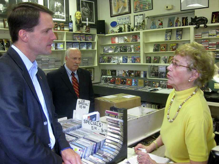 U.S. Rep. Jim Himes, D-4, left, joined by Westport First Selectman Gordon Joseloff, chats with Sally White, owner of Sally's Place, during his campaign swing Tuesday through downtown Westport. (Photo by Paul Schott.) Photo: Contributed Photo / Westport News