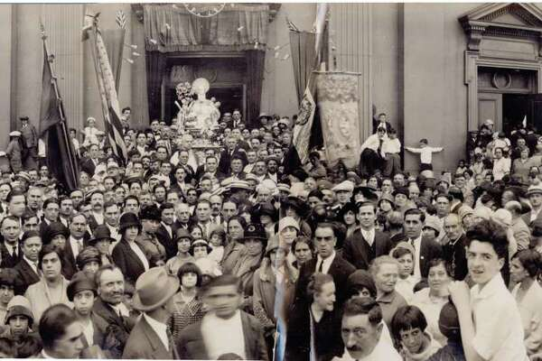 Crowds leave St. Michael Church on Wooster Square during the festa of the St. Andrew the Apostle Society, possibly in the 1930s. The society was founded by immigrants from Amalfi.
