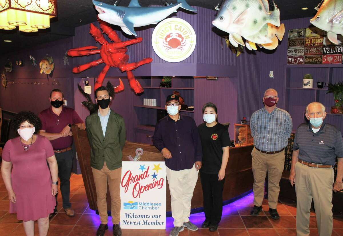 From left are Center Business Bureau chairwoman Pamela Steele, Director of Planning Conservation and Development Joseph Samolis, Middletown Mayor Ben Florsheim, Owner Bob Yu, his wife Lina Yu, Chamber chairman Thomas Byrne and Chamber president Larry McHugh. They all gathered recently for the grand opening of Juicy Cajun Seafood on Main Street in Middletown.