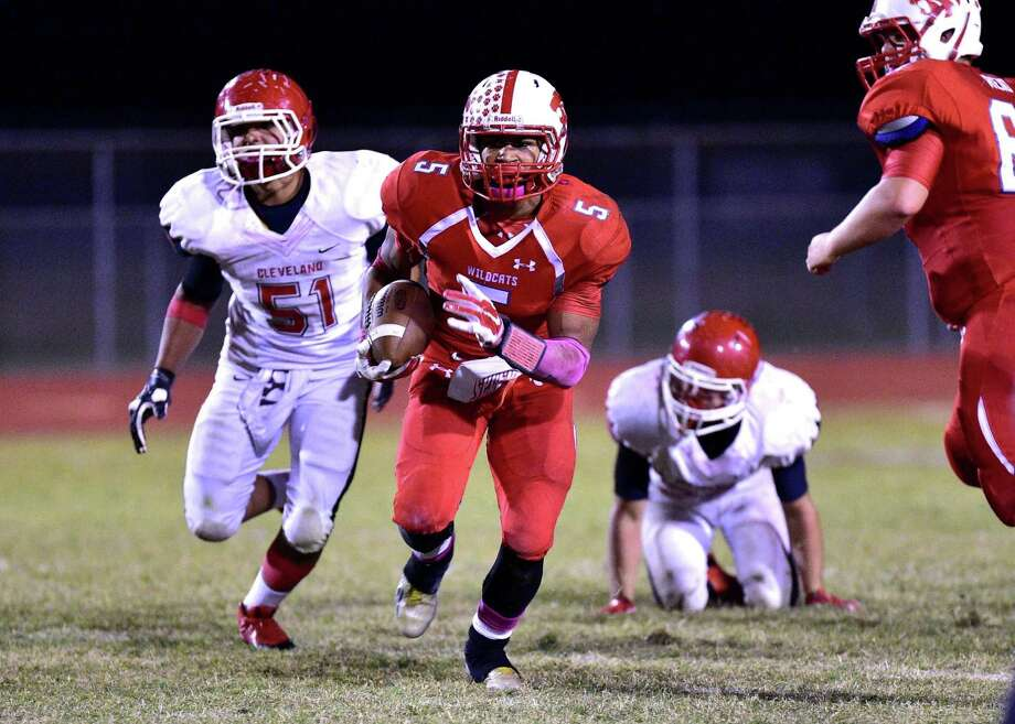 Jay Bradford (5) of the Splendora Wildcats runs away from a pursuing Jonathan Rodriguez (51) of the Cleveland Indians. Photo: Submitted / Internal