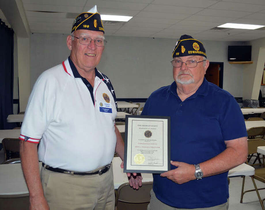 Edwardsville American Legion Post 199 Junior Commander Ron Swaim, left, and Commander John Pinegar, display the certificate of recognition that Post 199 received on Thursday for retaining 100 percent of its membership. Photo: Scott Marion | The Intelligencer
