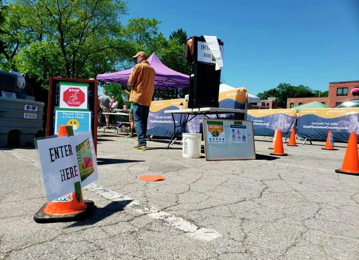 The Manistee Farmers Market has areas for hand washing at the entrance to the market and directional flow arrows throughout to guide visitors Saturday. (Arielle Breen/News Advocate)