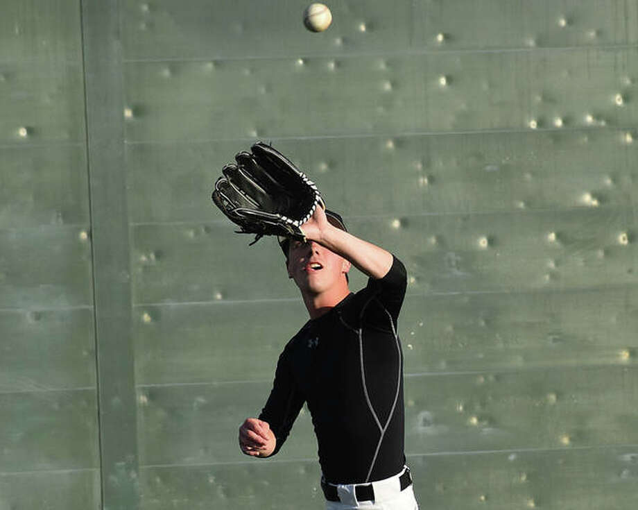 Edwardsville's Grant Coffey hauls in a fly ball in left field during Tuesday's practice at GCS Stadium in Sauget. Photo: Matt Kamp|The Intelligencer