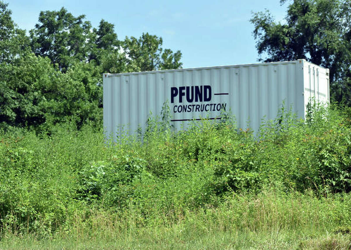 A storage unit of Pfund Construction sits on the lot of the new Peel Pizza site near the intersection of Esic Drive and Route 157.