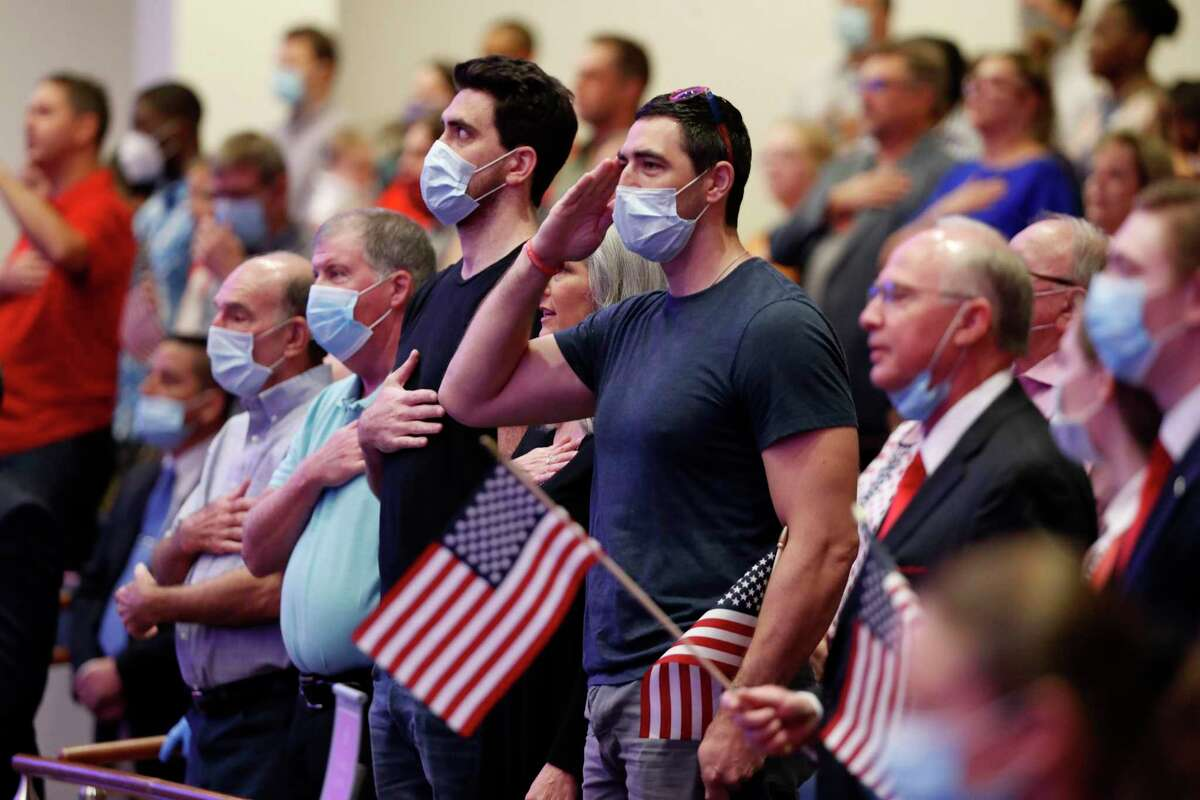 Attendees stand during the playing of the national anthem before Vice President Mike Pence made comments at First Baptist Church Dallas during a Celebrate Freedom Rally in Dallas, Sunday, June 28, 2020. (AP Photo/Tony Gutierrez)