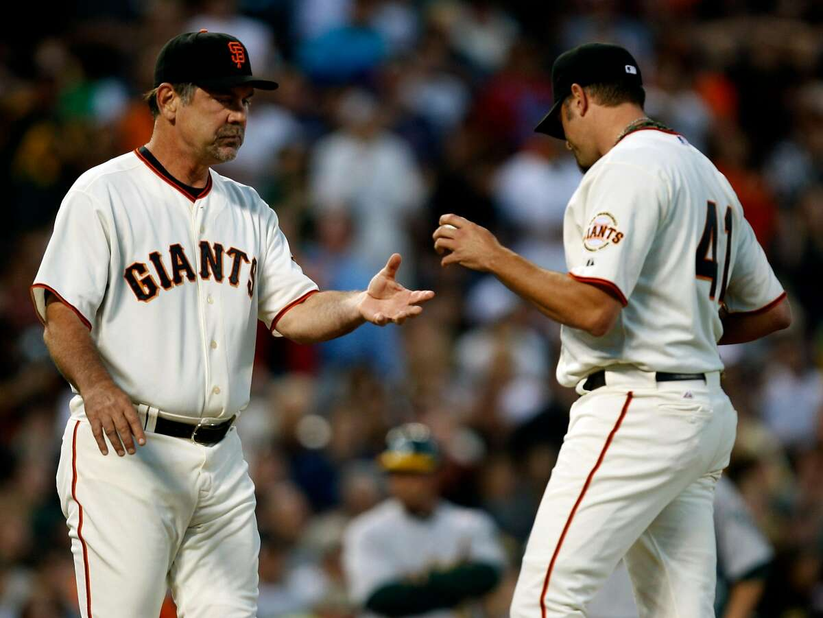 Manager Bruce Bochy takes the ball from reliever Jeremy Affeldt after the San Francisco Giants gave up two runs in the eighth inning at AT&T Park on Saturday.